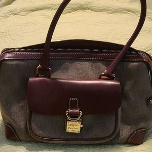 Vintage leather and cloth hand bag.